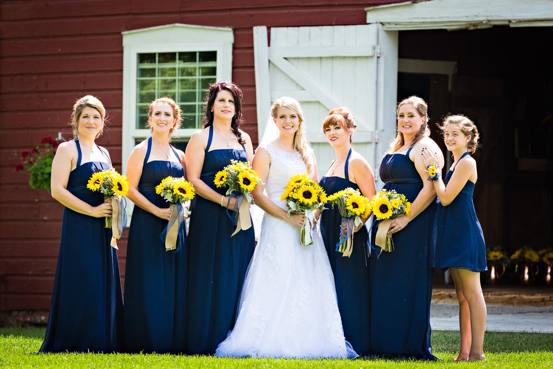 bozeman-montana-wedding-roys-barn-bride-bridesmaids-by-barn.jpg