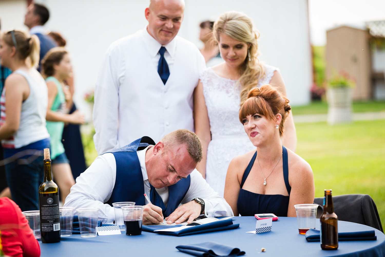 bozeman-montana-wedding-roys-barn-best-man-signs-license.jpg