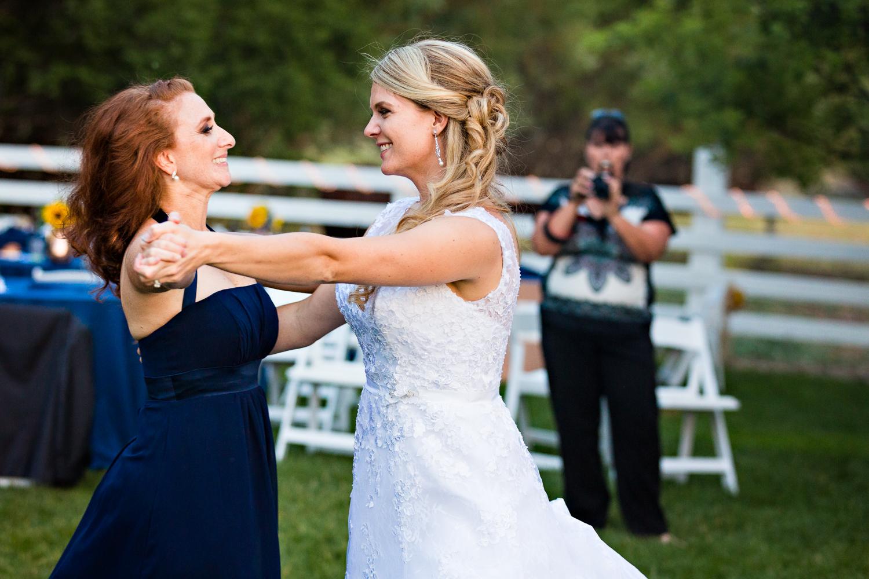 bozeman-montana-wedding-roys-barn-bride-friend-dance.jpg