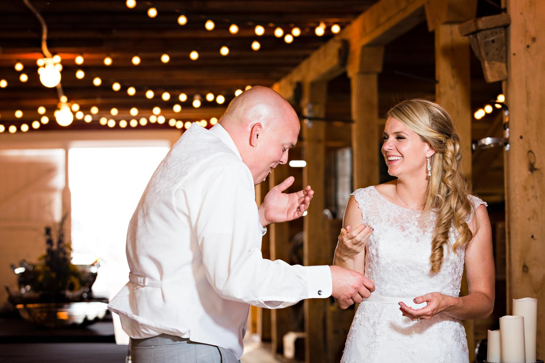 bozeman-montana-wedding-roys-barn-bride-groom-cut-cake.jpg