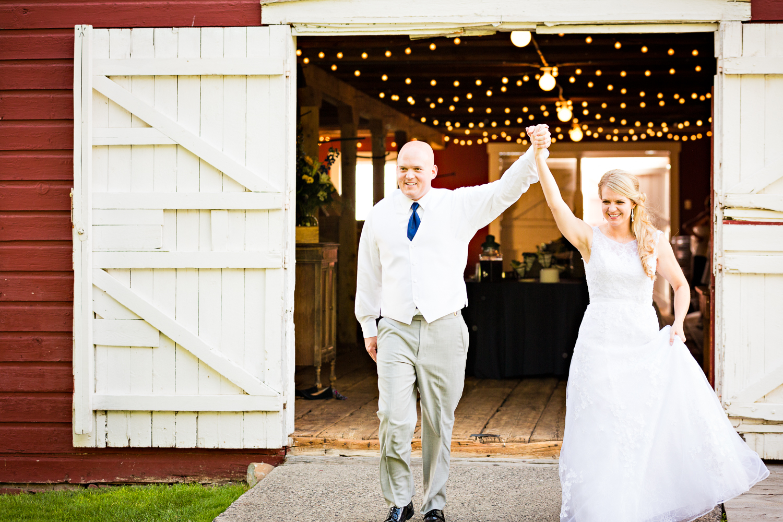bozeman-montana-wedding-roys-barn-bride-groom-enter-reception.jpg