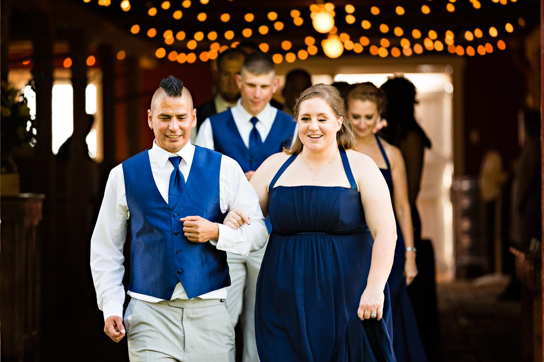 bozeman-montana-wedding-roys-barn-bridemaid-groomsmen-enter-reception.jpg