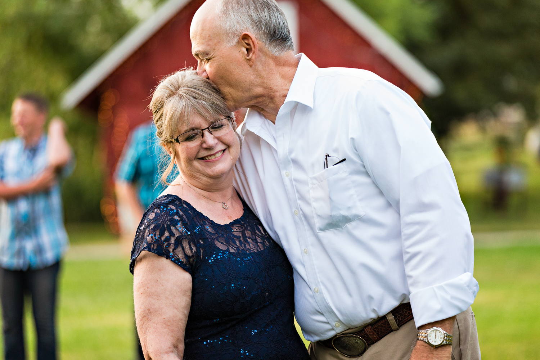 bozeman-montana-wedding-roys-barn-brides-father-kisses-wife.jpg