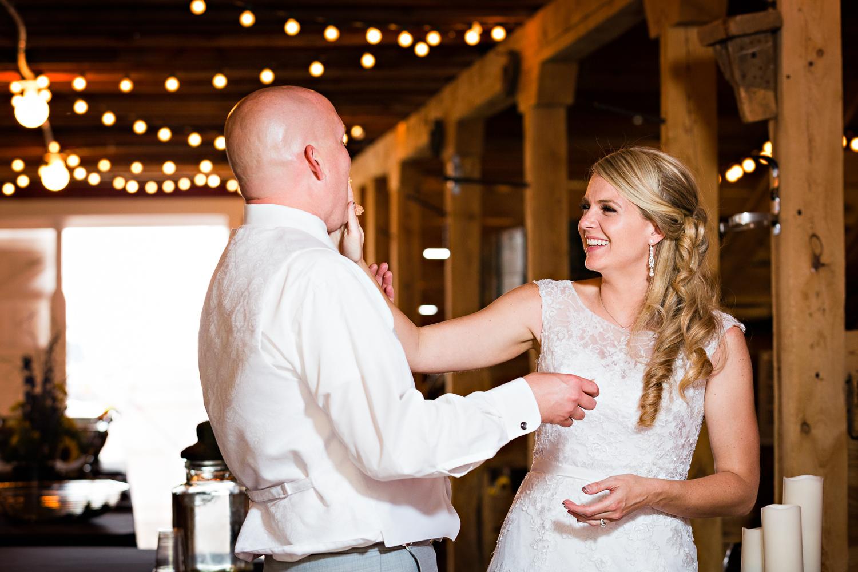 bozeman-montana-wedding-roys-barn-bride-smashes-cake.jpg