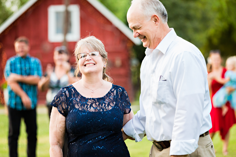 bozeman-montana-wedding-roys-barn-brides-parents-laughing.jpg