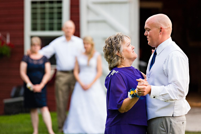 bozeman-montana-wedding-roys-barn-groom-mother-dance-with-bride-in-background.jpg