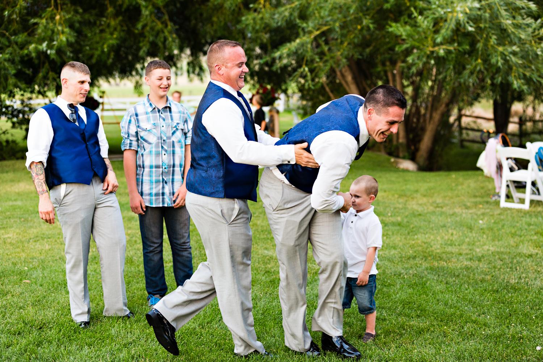 bozeman-montana-wedding-roys-barn-man-catches-garter.jpg