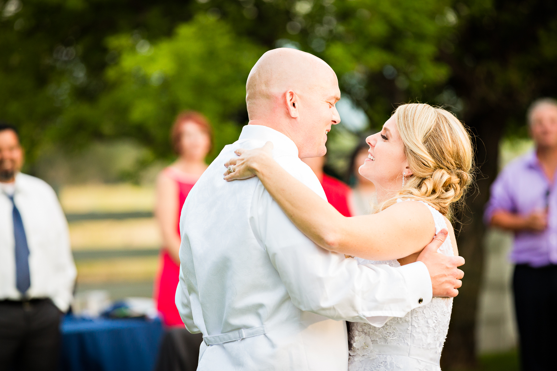 bozeman-montana-wedding-roys-barn-bride-groom-smile-during-first-dance.jpg