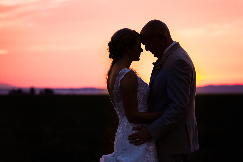 bozeman-montana-wedding-roys-barn-couple-embraces-at-sunset.jpg