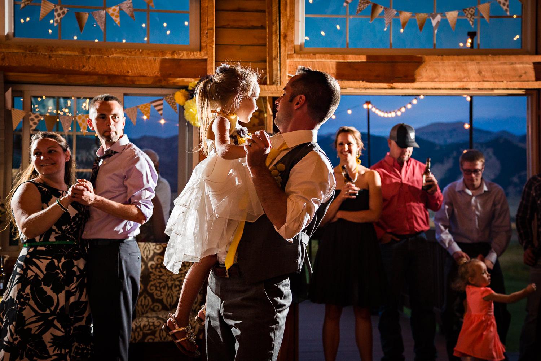 bozeman-wedding-big-yellow-barn-groom-flowergirl-dancing.jpg