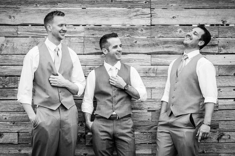 bozeman-wedding-big-yellow-barn-groomsmen-groom-laughs.jpg
