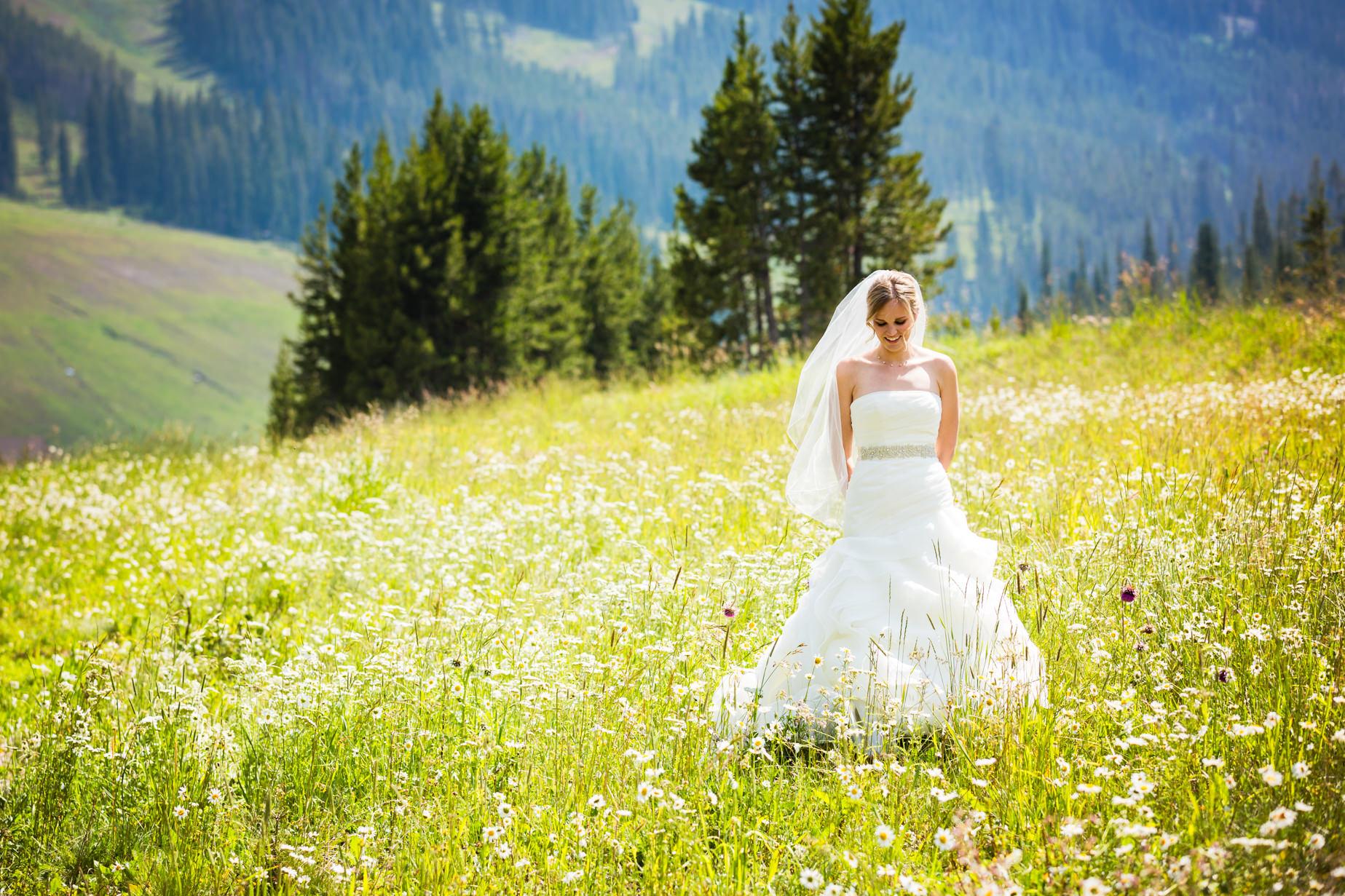 big-sky-resort-wedding-bride-waits-for-groom-in-field.jpg
