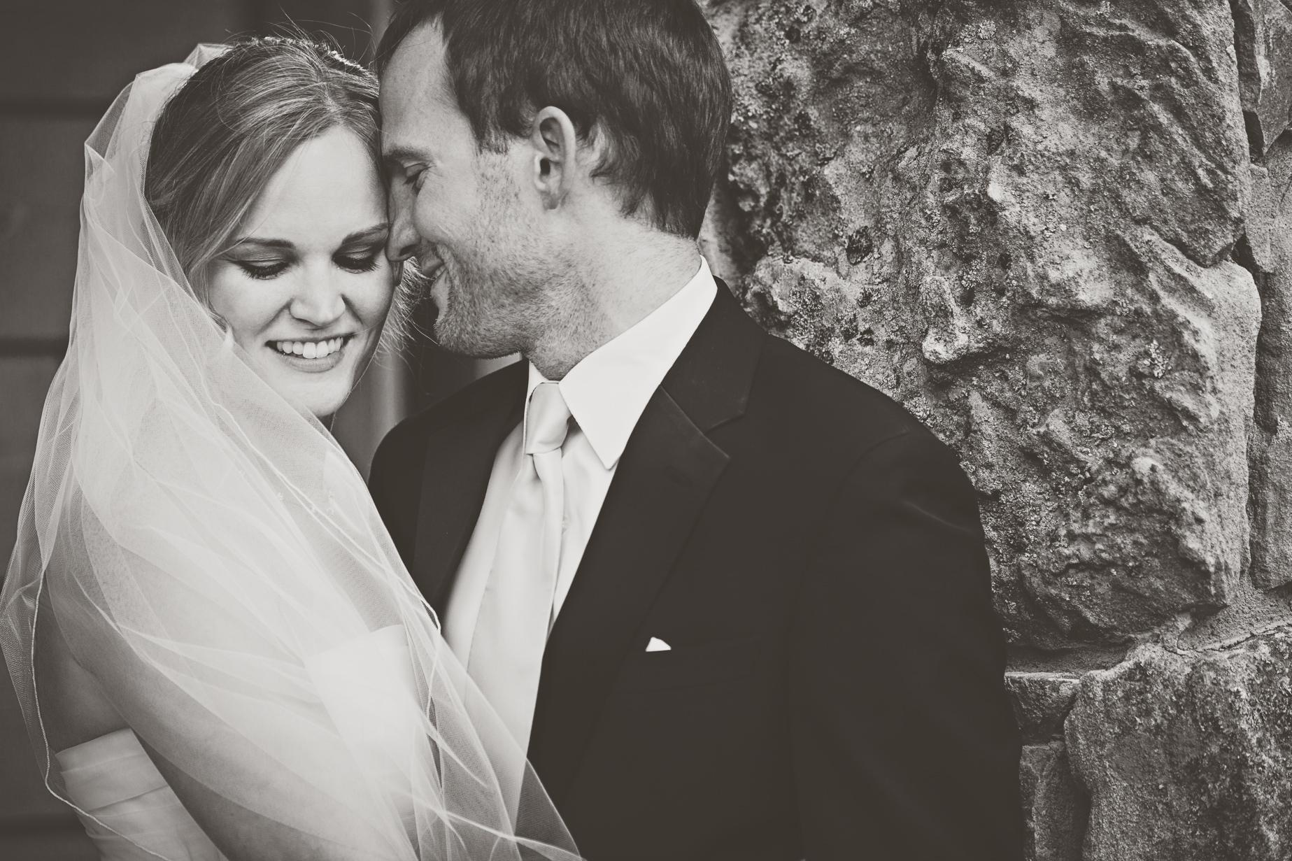 big-sky-resort-wedding-groom-kisses-brides-cheek.jpg