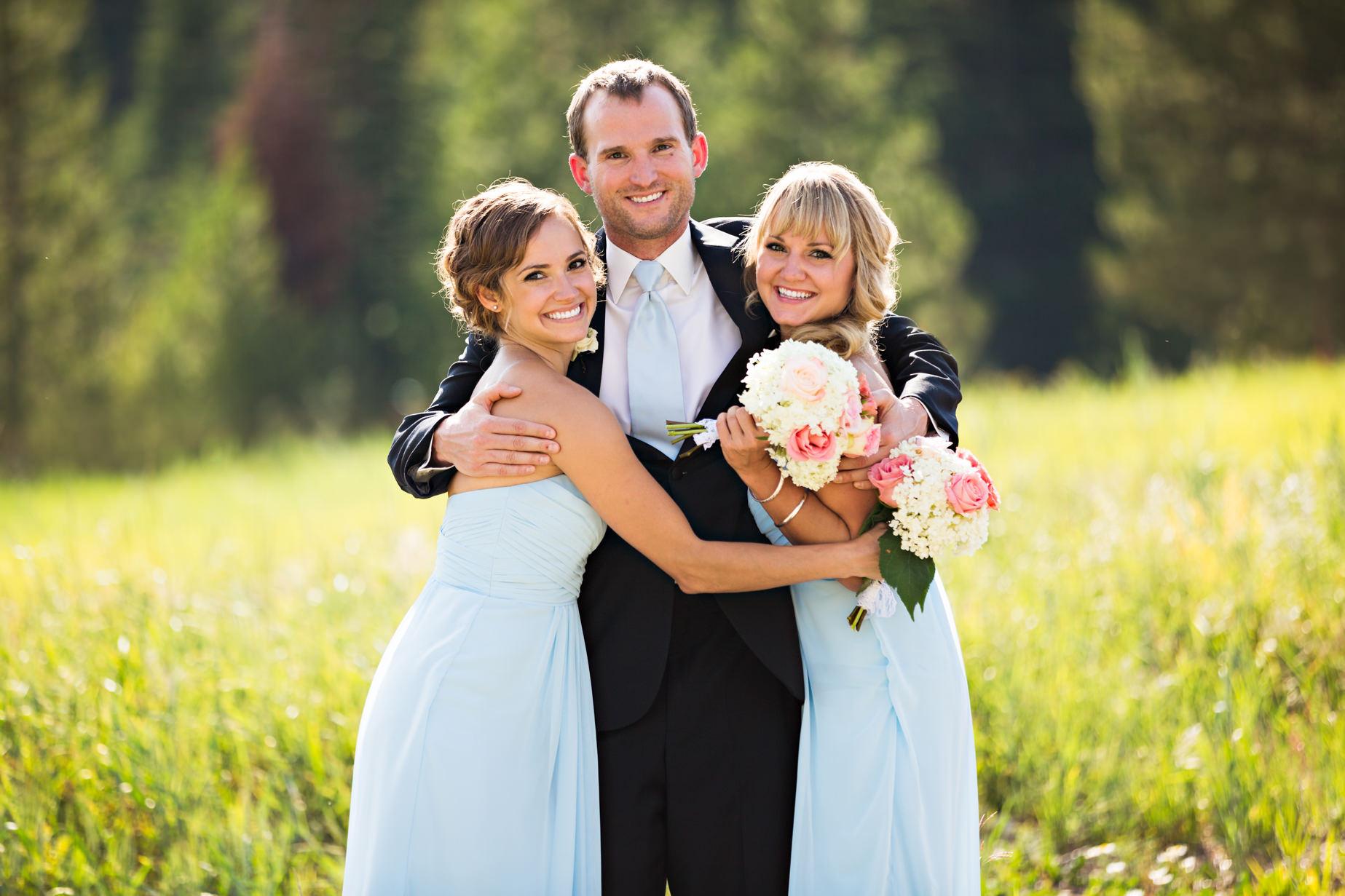 big-sky-resort-wedding-groom-hugs-sisters.jpg