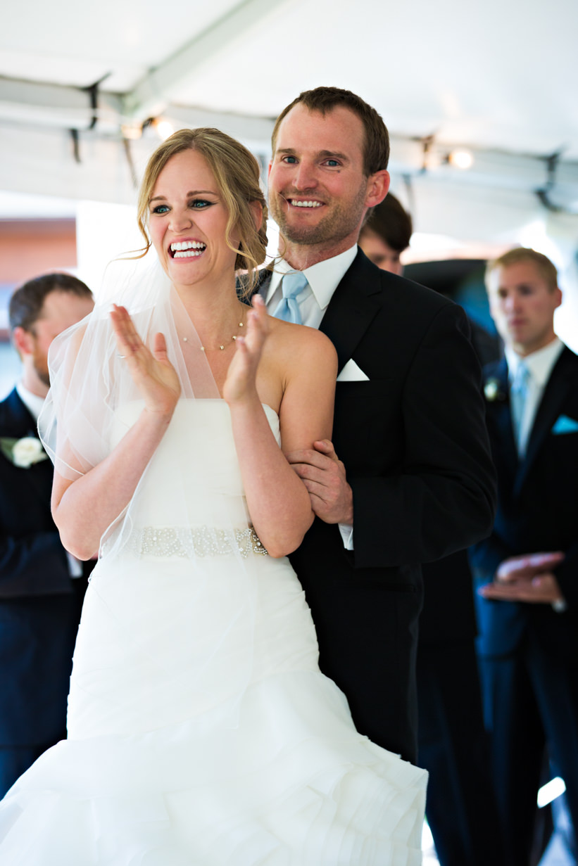 big-sky-resort-wedding-bride-claps-during-ceremony.jpg