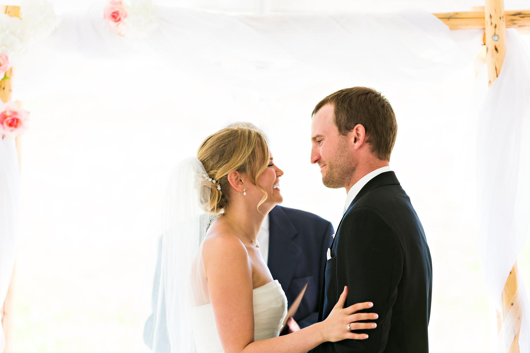 big-sky-resort-wedding-bride-groom-laughing-after-just-married.jpg