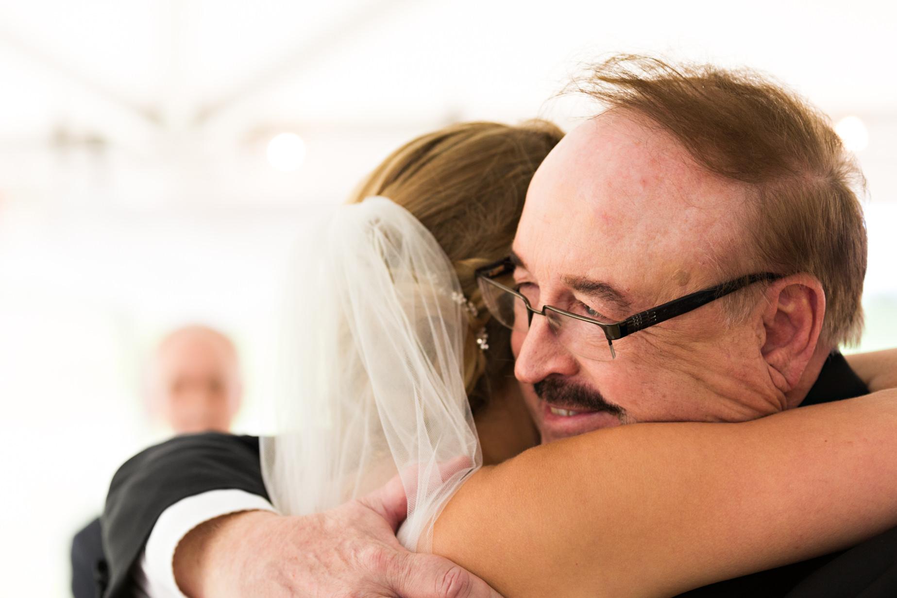 big-sky-resort-wedding-bride-hugs-father.jpg
