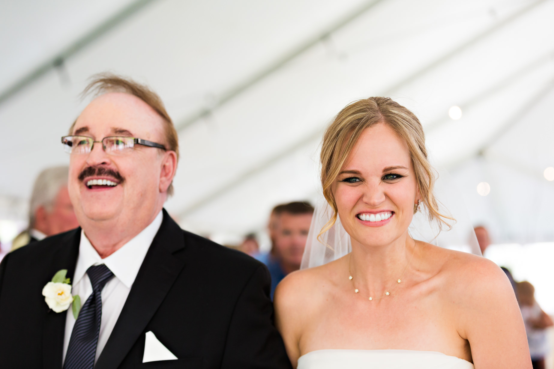 big-sky-resort-wedding-bride-smiles-at-groom-while-walking-up-aisle.jpg