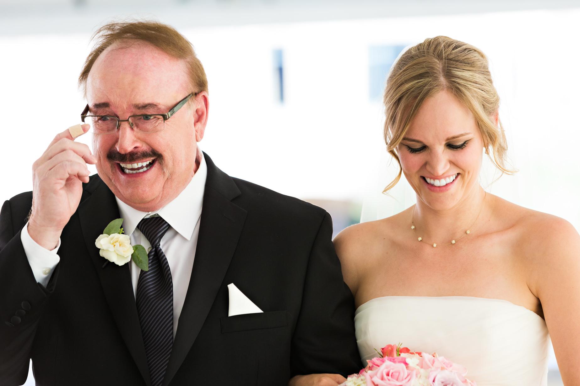 big-sky-resort-wedding-father-cries-while-walking-daughter-down-aisle.jpg