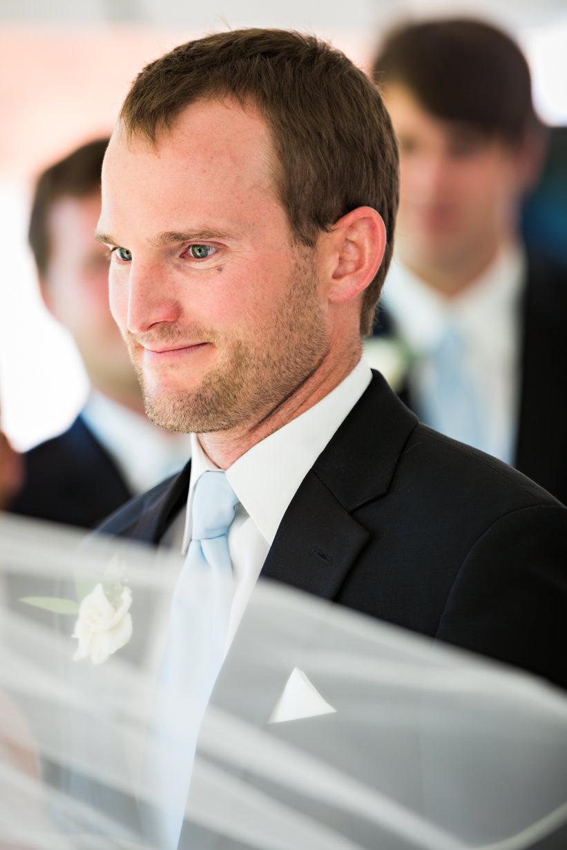 big-sky-resort-wedding-groom-looks-at-bride-during-ceremony.jpg