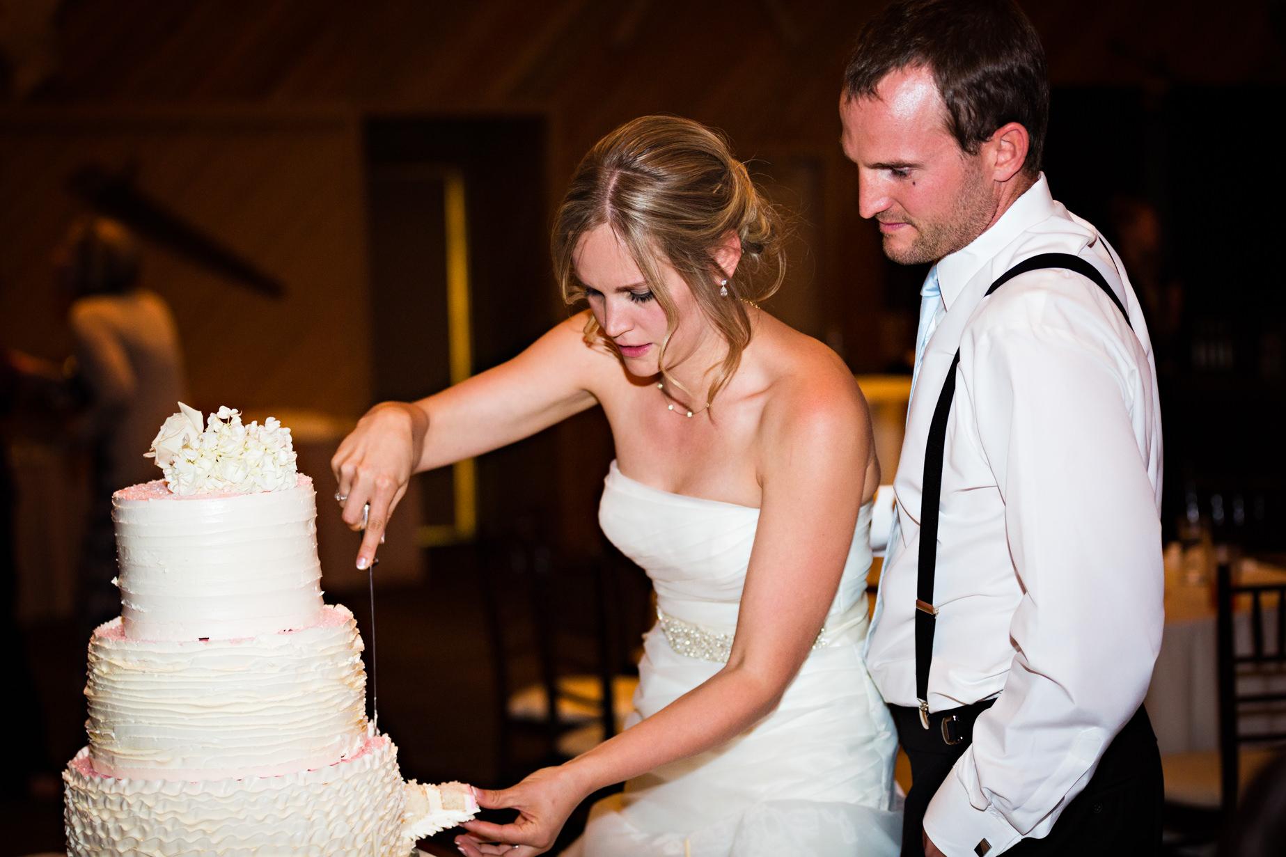 big-sky-resort-wedding-bride-groom-cut-cake.jpg