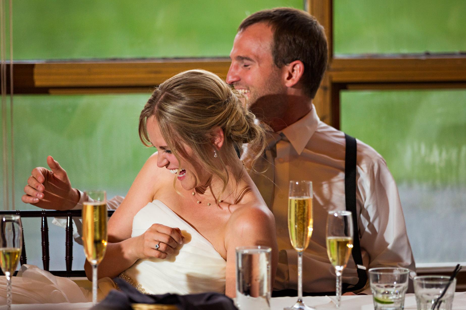 big-sky-resort-wedding-bride-groom-laugh-during-toasts.jpg