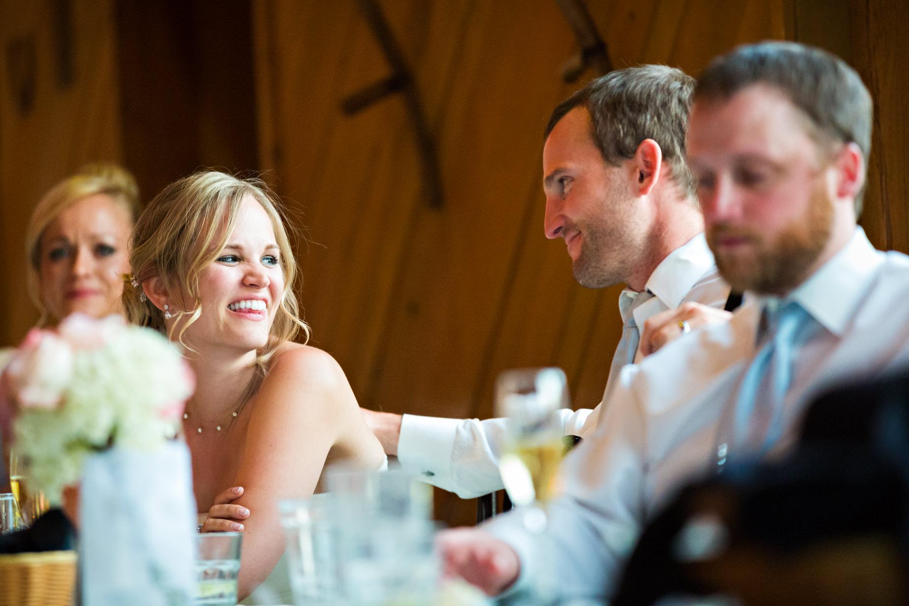 big-sky-resort-wedding-bride-looking-at-groom-during-meal.jpg