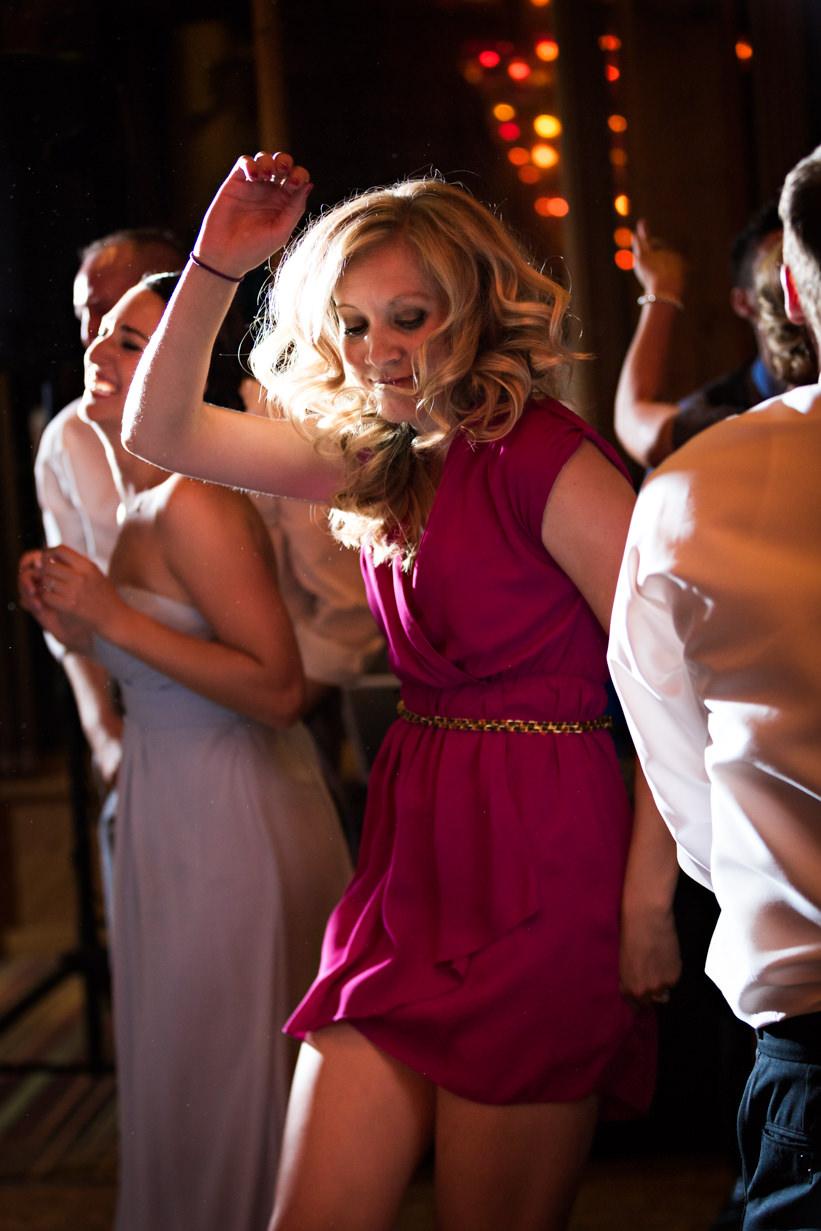 big-sky-resort-wedding-female-dances-pink-dress.jpg