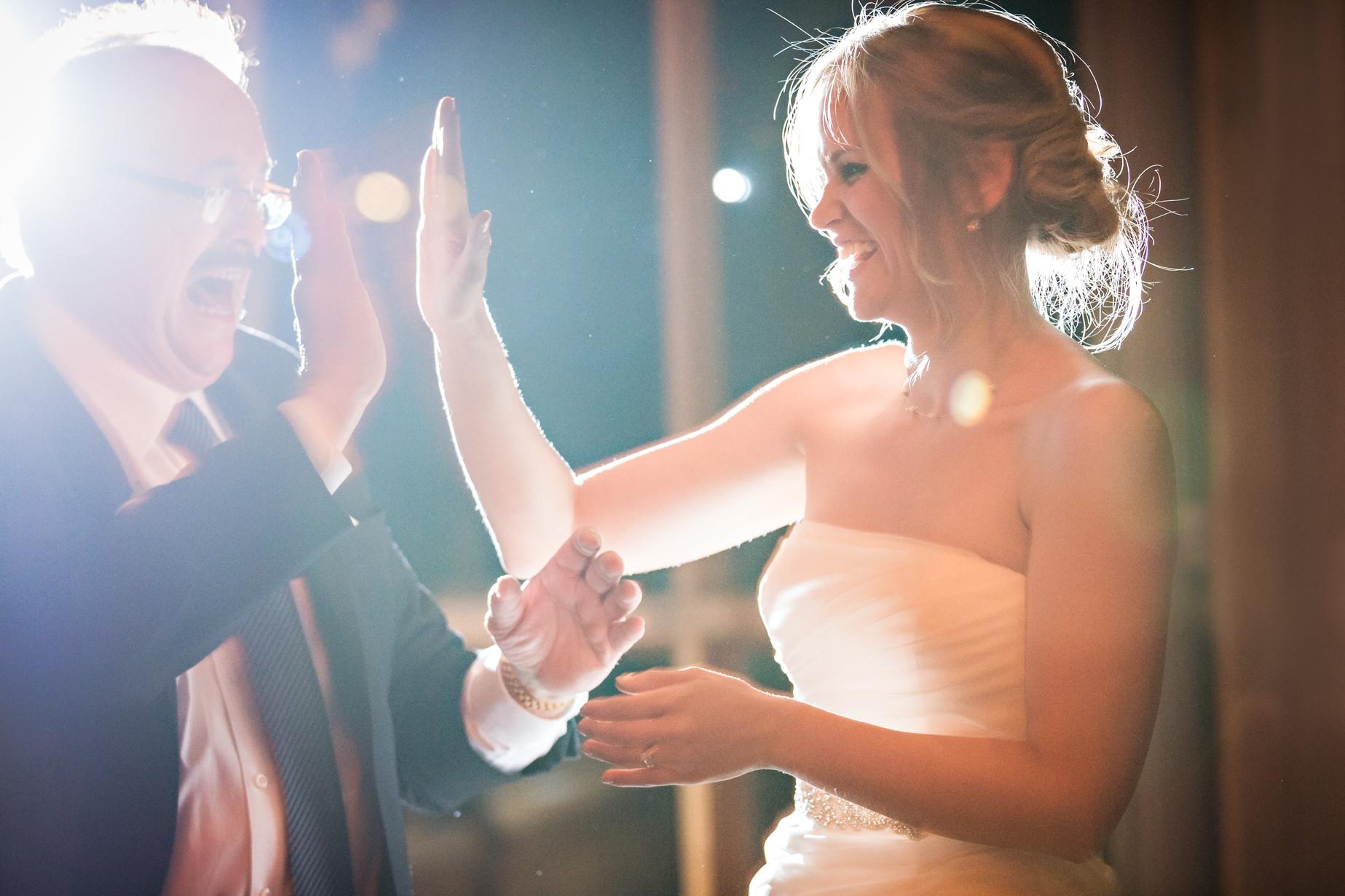 big-sky-resort-wedding-father-daughter-high-five.jpg