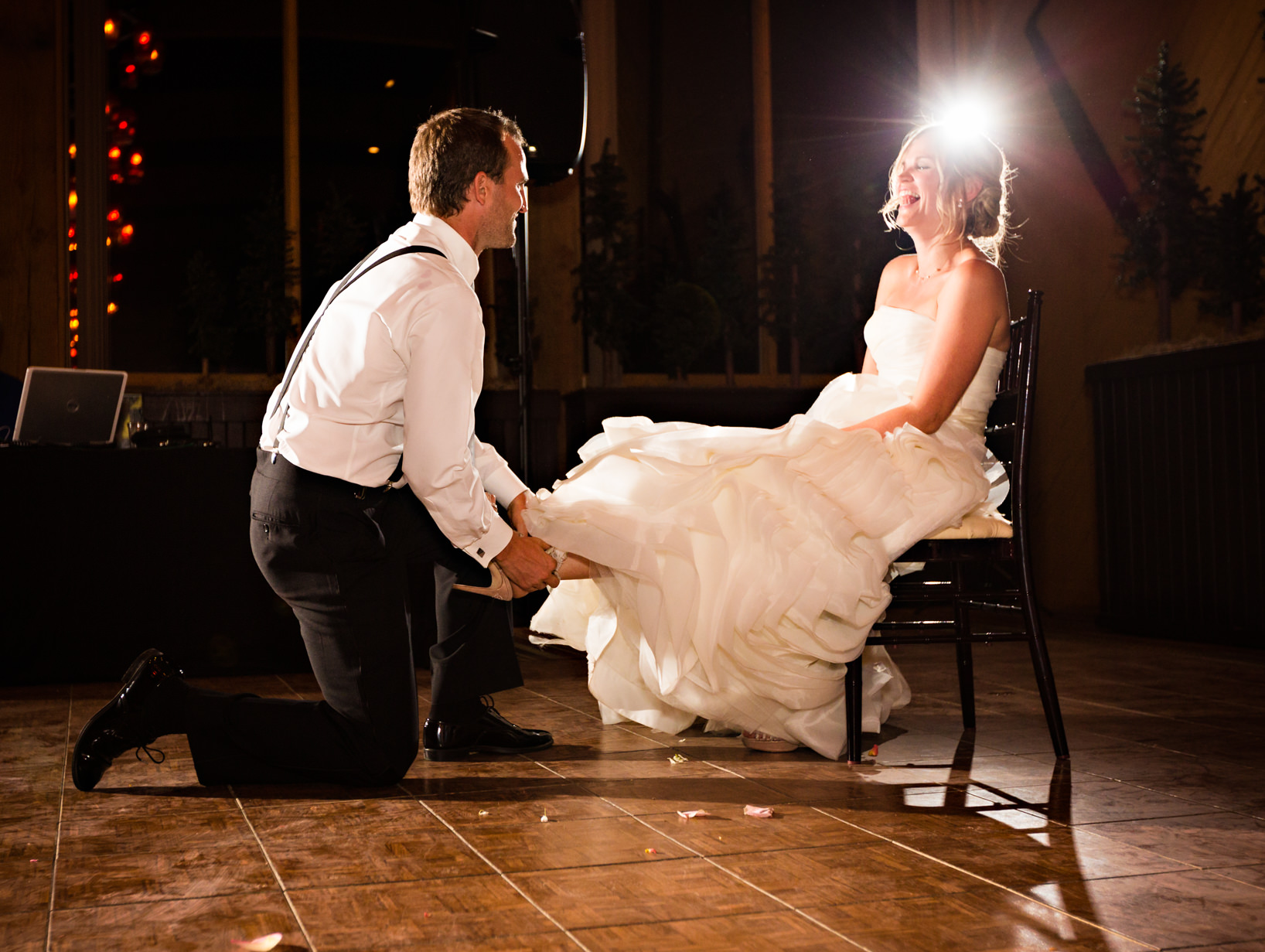 big-sky-resort-wedding-groom-removes-garter.jpg