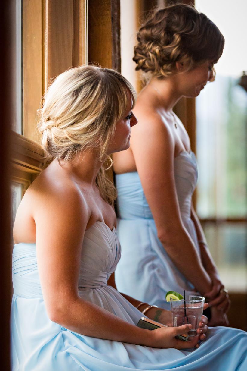 big-sky-resort-wedding-grooms-sisters-watching-video.jpg