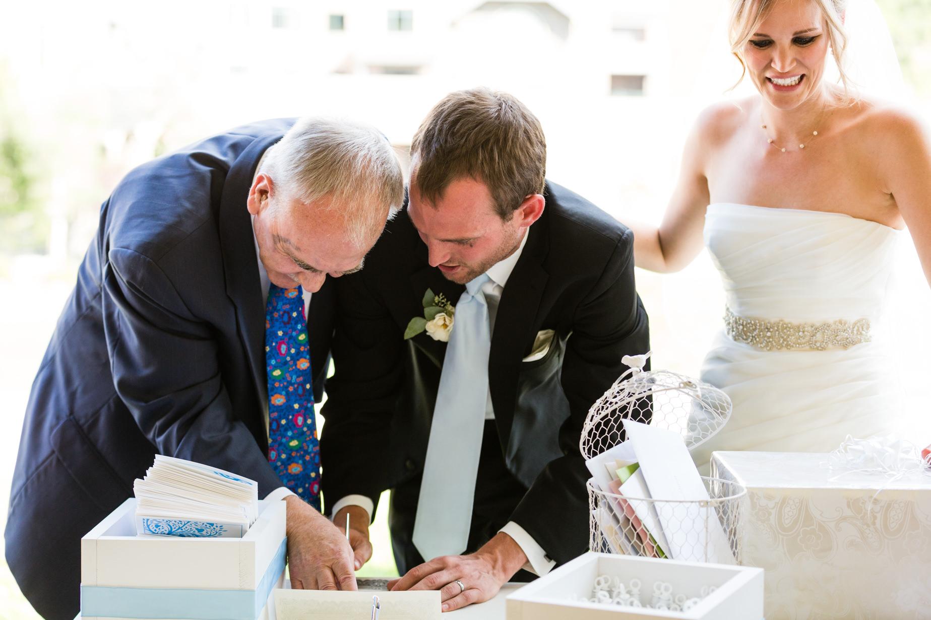 big-sky-resort-wedding-groom-signs-marriage-license.jpg