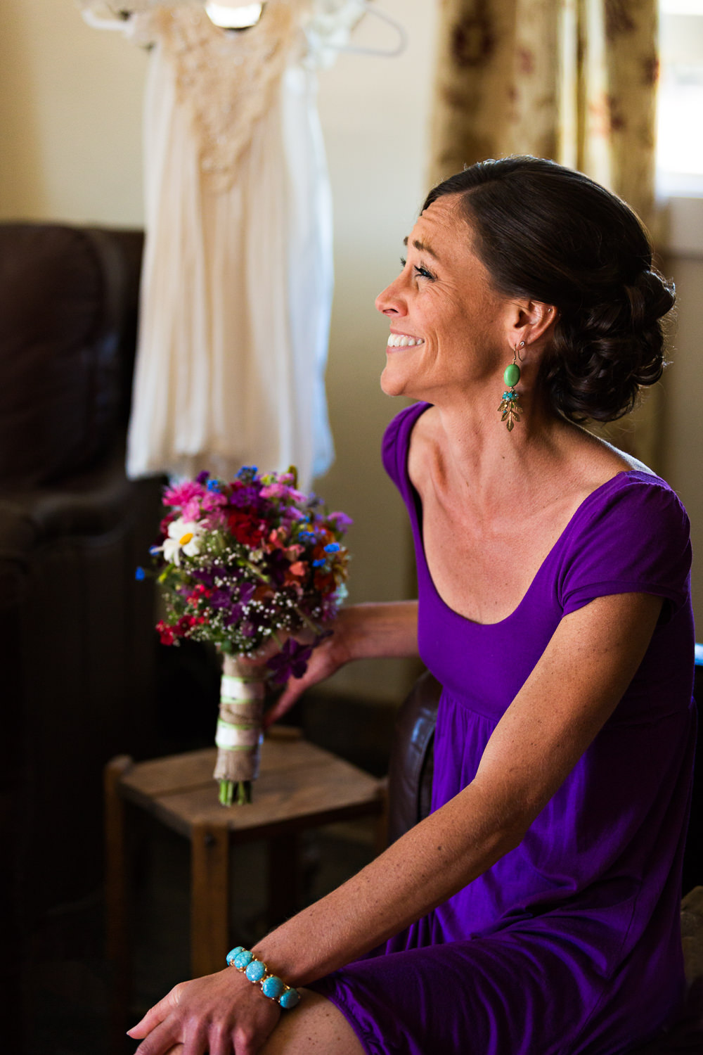 mcleod-montana-wedding-bride-laughs-while-getting-ready.jpg