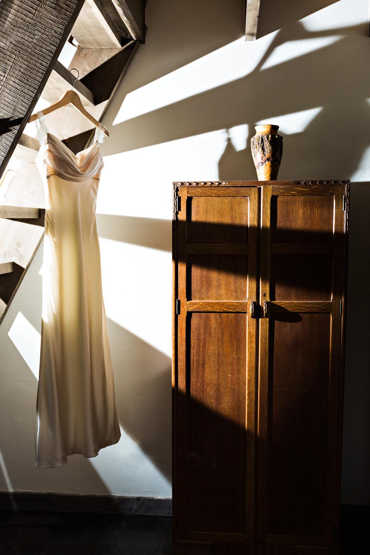 mcleod-montana-wedding-wedding-dress-shadowed-by-stairs.jpg