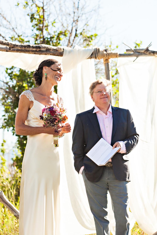 mcleod-montana-wedding-bride-smiles-during-ceremony.jpg