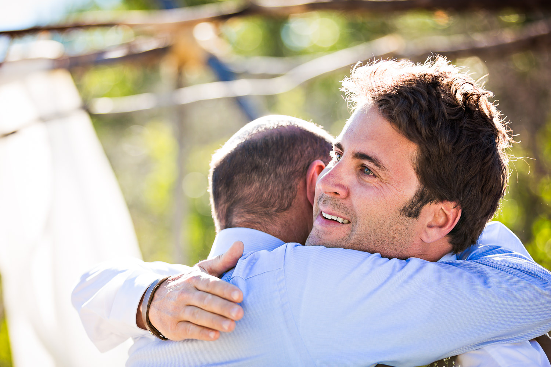 mcleod-montana-wedding-groom-hugs-father-in-law.jpg