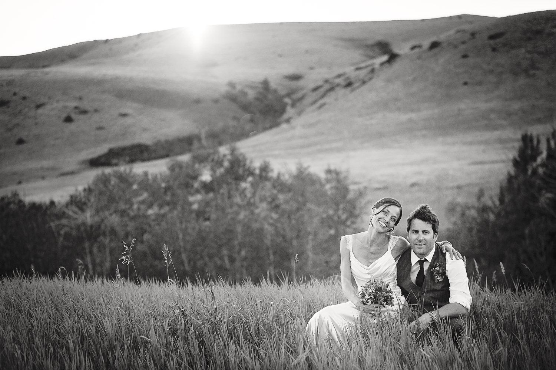 mcleod-montana-wedding-couple-sitting-grass-at-sunset.jpg