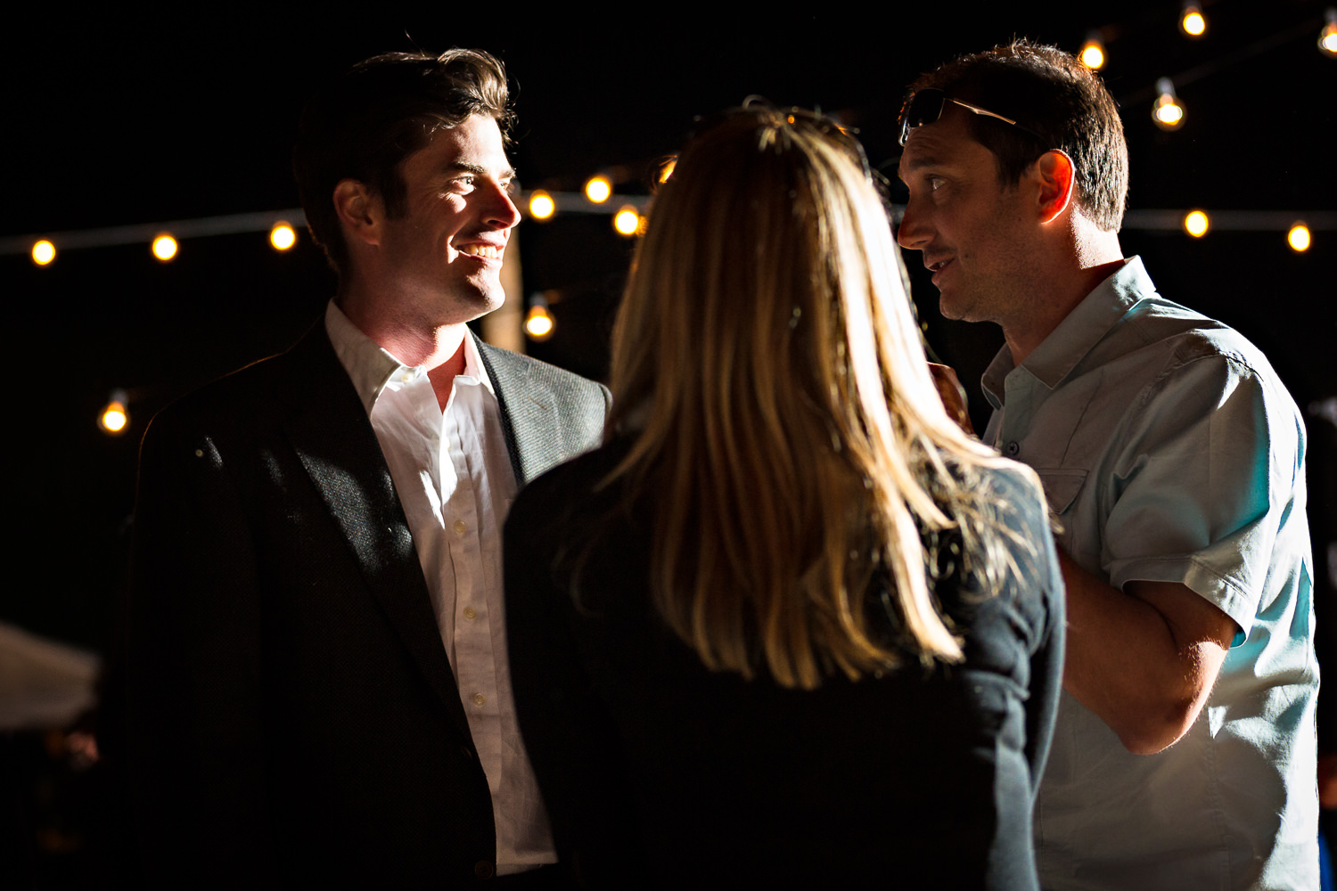 mcleod-montana-wedding-male-guests-laughing-at-reception.jpg