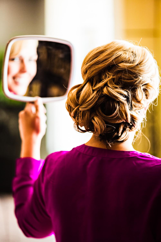 missoula-museum-mountain-flying-wedding-bride-admiring-hair.jpg