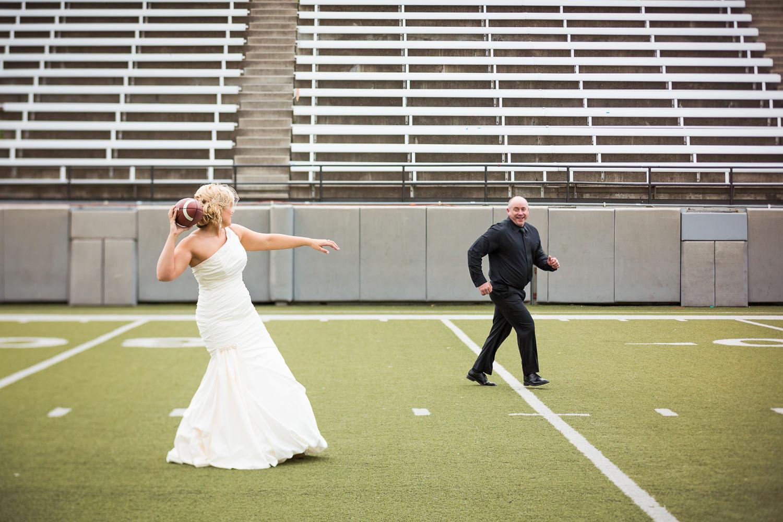 missoula-museum-mountain-flying-wedding-bride-tosses-football.jpg