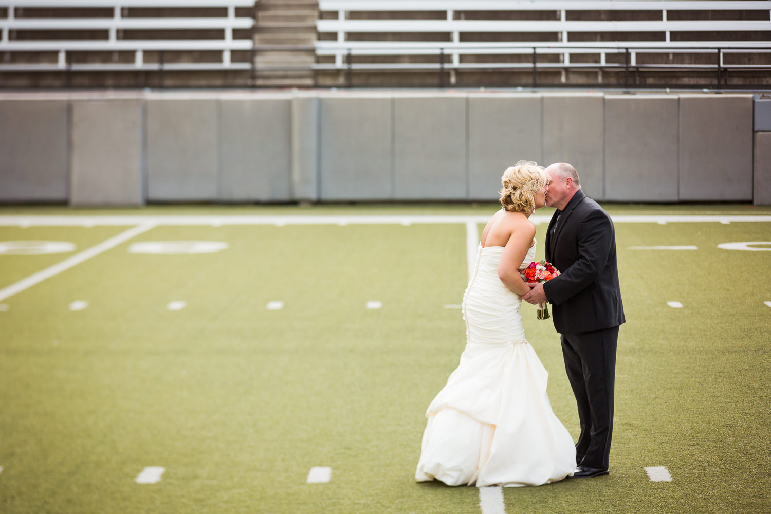 missoula-museum-mountain-flying-wedding-couple-kissing-first-look.jpg