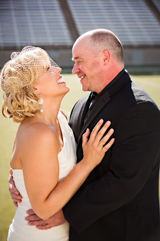 missoula-museum-mountain-flying-wedding-couple-laughing-football-field.jpg