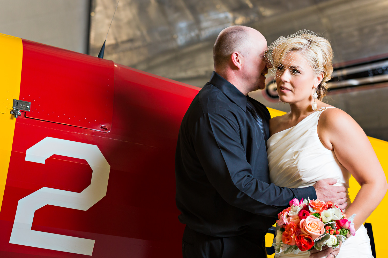 missoula-museum-mountain-flying-wedding-groom-whispers-in-brides-ear.jpg