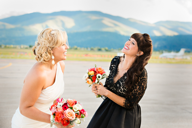 missoula-museum-mountain-flying-wedding-bride-maid-honor-laughing.jpg