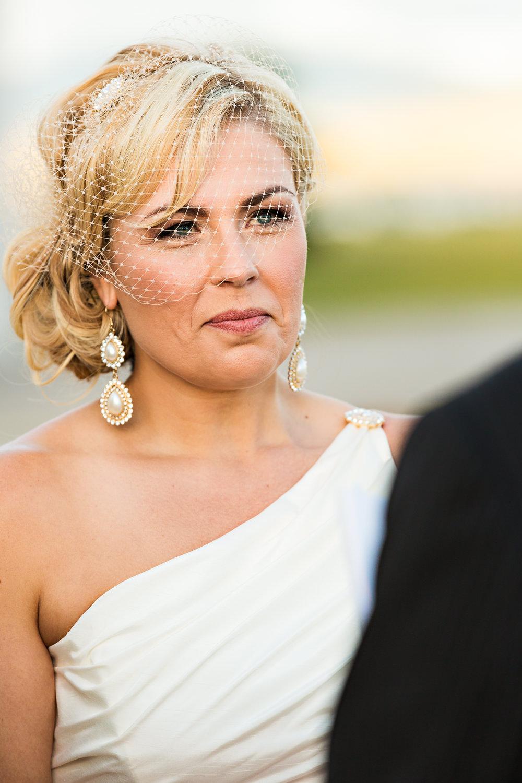 missoula-museum-mountain-flying-wedding-bride-smiles-during-ceremony.jpg