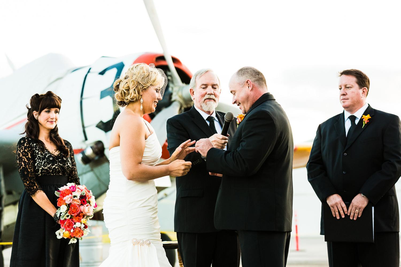 missoula-museum-mountain-flying-wedding-couple-exchanges-rings.jpg