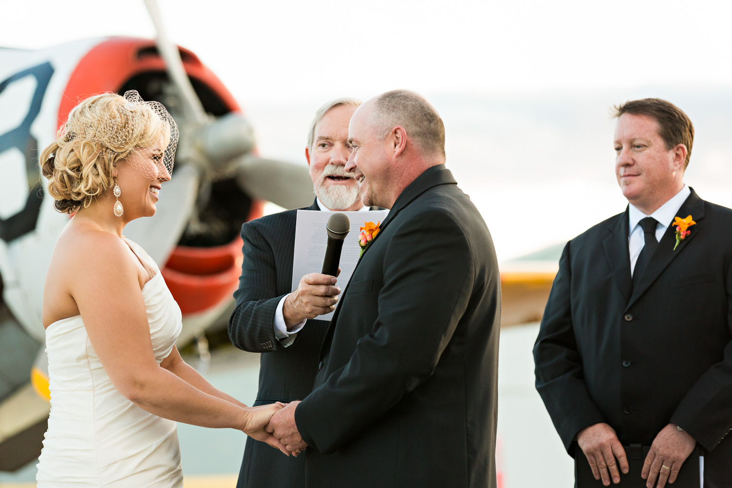 missoula-museum-mountain-flying-wedding-couple-laughs-exchanging-vows.jpg