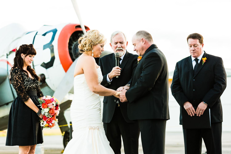 missoula-museum-mountain-flying-wedding-couple-prays-during-ceremony.jpg
