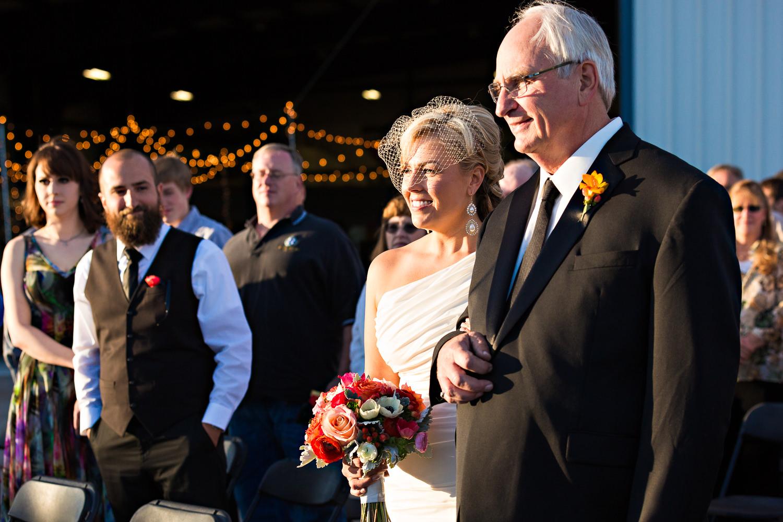 missoula-museum-mountain-flying-wedding-father-walks-bride-up-aisle.jpg