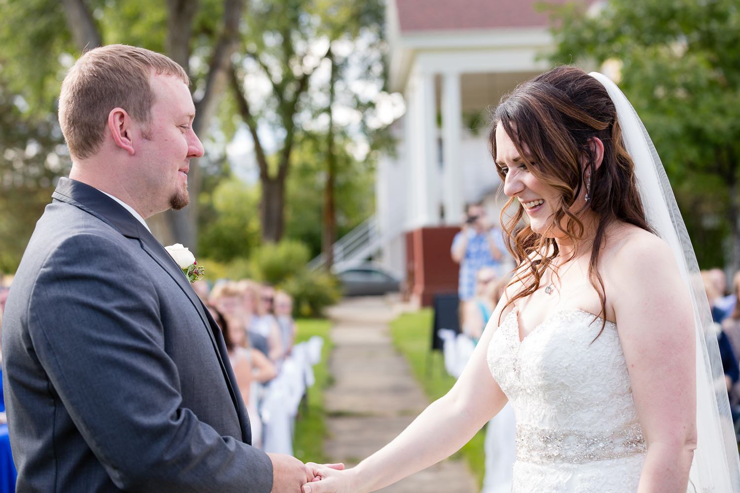 heritage-hall-missoula-montana-bride-groom-laugh-during-ceremony.jpg